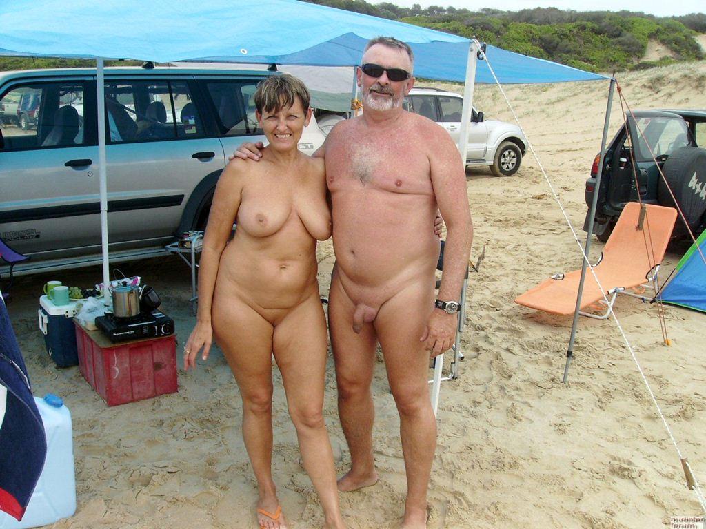 Nude guy bending over