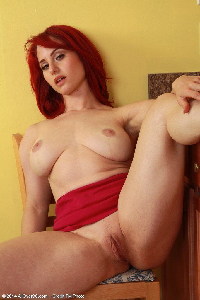 Plump redhead bitch spreading pussy hot nude