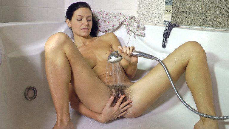 Naked lovers under shower
