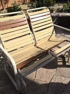 Swinging wooden garden benches replace bench