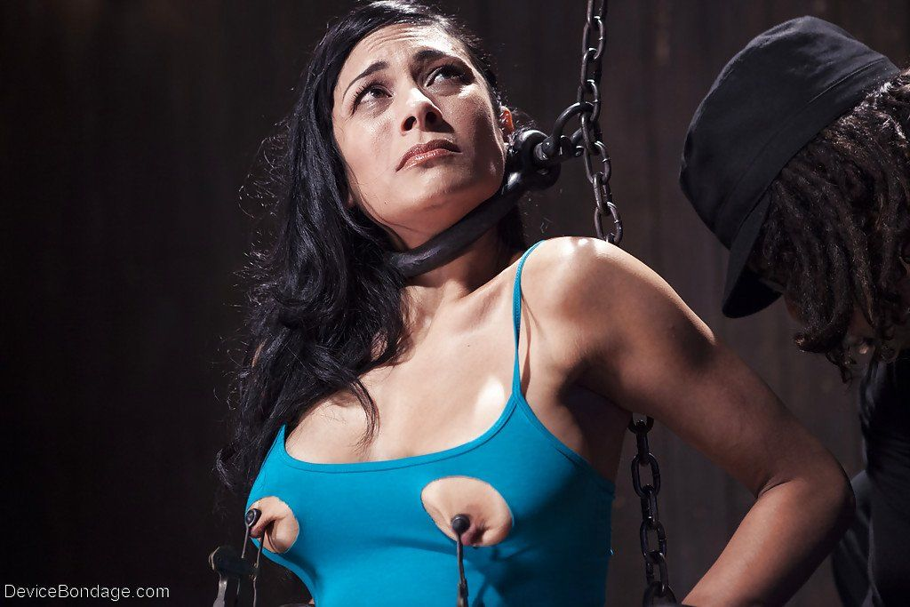 Bondage stretching female nipples